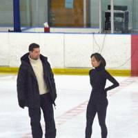 Coach's choice: Nikolai Morozov and two-time world champion Miki Ando have had a successful partnership in their five years together. Fate may have played a different hand if Morozov had chosen an alternative option. | KYODO