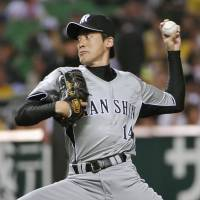 Pack your bags: Atsushi Nomi and the Hanshin Tigers won't return to Koshien Stadium until Aug. 26. | KYODO PHOTO