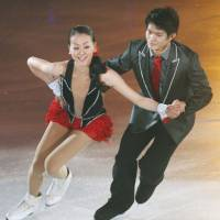 Terrific tandem: Mao Asada and Takahiko Kozuka perform together at a recent charity show in Hachinohe, Aomori Prefecture, for victims of the March 11 Tohoku disaster. | KYODO
