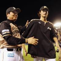 Uncertain future: Fighters manager Masataka Nashida and ace Yu Darvish could be parting ways after this season. | KYODO PHOTO