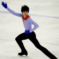Strong start: Ryuju Hino, who is coached by Hiroshi Nagakubo, won the season-opening Junior Grand Prix in Riga, Latvia, earlier this month with an impressive free skate. | KYODO