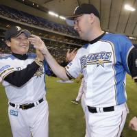 Let's stay together: Bobby Keppel (right) and the Fighters are rallying around manager Masataka Nashida (left) who announced last week that he would step down at the end of the season. | KYODO PHOTO