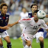Growing pains: Hiroshi Kiyotake (left) has impressed since making his national debut this summer but will miss Japan's upcoming games against Vietnam and Tajikistan through injury. | AP