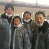 Helping those in need: (Left to right) Sendai 89ers forward Daisuke Takaoka, guard and team captain Takehiko Shimura, guard Hikaru Kusaka and former coach Honoo Hamaguchi helped with relief efforts after the Great East Japan Earthquake in the spring. Shimura is a team leader and active in volunteer efforts off the court. | SENDAI 89ERS / BJ-LEAGUE