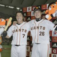 Counting on you: Hisayoshi Chono (left) helped make Tetsuya Utsumi an 18-game winner with a walk-off grand slam in his final at-bat of the regular season. | KYODO PHOTO