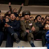 One for all: North Korean fans watch their country's World Cup qualifier against Uzbekistan at Pyongyang's Yanggakdo Stadium last month. | AP