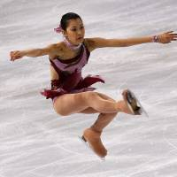 Teenage kicks: Kanako Murakami performs her short program at the Trophee Bompard in Paris on Friday. Murakami finished the day in fourth place. | AP PHOTO