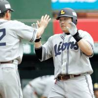 Help me out: Takeya Nakamura's spectacular 48-home run campaign might have garnered more MVP consideration had the third-place Lions finished a little higher in the standings. | KYODO PHOTO