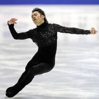 Poetry in motion: Daisuke Takahashi skates during the men's short program at the national championships Friday in Kadoma, Osaka Prefecture. Takahashi leads the field with 96.05 points. | KYODO