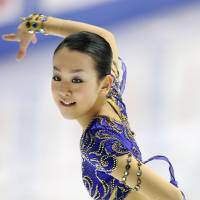 Dazzling return: Mao Asada skates during the women's short program on Saturday at the national championships in Kadoma, Osaka Prefecture. Mao is in second place with 65.40 points. | KYODO PHOTO