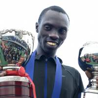 Day to remember: Kenya's Vincent Kipruto displays his championship hardware after a dramatic finish in the Lake Biwa Marathon on Sunday in Otsu, Shiga Prefecture. | KYODO