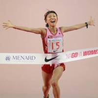 Seize the day: Ryoko Kizaki crosses the line to win the Nagoya Women's Marathon on Sunday. | KYODO