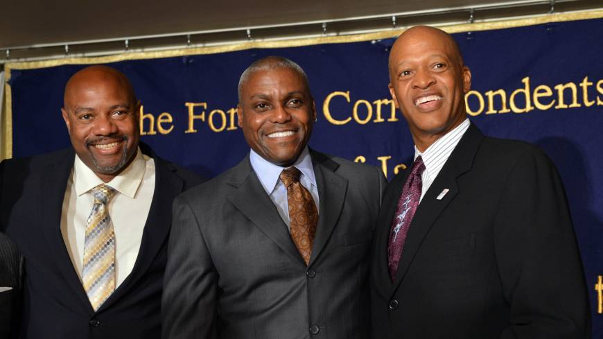 Mt. Rushmore on the road: Nine-time Olympic gold medalist Carl Lewis (center) stands with long jump world record holder Mike Powell (left) and former triple jump world record holder Willie Banks on Monday at the Foreign Correspondents' Club of Japan in Tokyo.