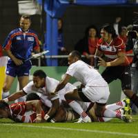 Down and dirty: Japan openside flanker Michael Leitch scores a try for the Brave Blossoms against Tonga during the first half of  their clash at the Rugby World Cup on Wednesday. Tonga won 31-18. | AKI NAGAO