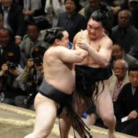 Overpowering: Yokozuna Asashoryu forces out sekiwake Ama on Monday during the Summer Grand Sumo Tournament at Tokyo's Ryogoku Kokugikan. | KYODO PHOTO