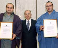 Drug scandal: Third-ranked maegashira Roho (right) and juryo wrestler Hakurozan, Roho's younger brother, shown here as they were awarded for their sumo performances by Russian Consulate General in Osaka in 2004, tested positive for marijuana after on-the-spot urine checks at Tokyo's Ryogoku Kokugikan on Tuesday. | KYODO PHOTO