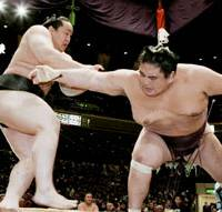 Stay undefeated: Yokozuna Asashoryu slams down Miyabiyama for a 4-0 start at the New Year Grand Sumo Tournament on Wednesday at Ryogoku Kokugikan in Tokyo. | KYODO PHOTO