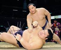 Great escape: Kaio defeats Takekaze at the New Year Grand Sumo Tournament at Ryogoku Kokugikan on Thursday to secure his ozeki status for the spring basho. | KYODO PHOTO
