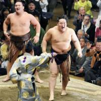 Back on top: Asashoryu exults after beating Hakuho in a championship playoff to win the New Year Grand Sumo Tournament on Sunday. | KYODO PHOTO