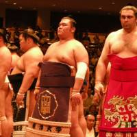 The inner circle: Sumo rikishi, including Georgian makunouchi wrestler Kokkai (far right), perform the hallowed dohyo-iri (ring-entering) ceremony. | MARK BUCKTON PHOTO