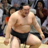 Hard to swallow: Asashoryu reacts to defeat by Kisenosato at the Nagoya Grand Sumo Tournament on Sunday. | KYODO PHOTO