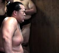 Practice, practice: Fatigue shows on a sumo wrestler's face during an asageiko. | HARUNA MIYASHITA PHOTO