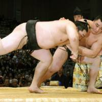 Falling fast: Harumafuji sends Asashoryu to his first loss of the Kyushu Grand Sumo Tournament on Thursday in Fukuoka. | KYODO PHOTO