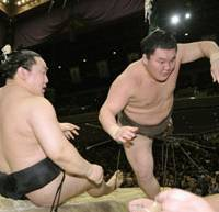 Last word: Hakuho flies out of the ring after taking down tournament-winner Asashoryu on the final day of the New Year Grand Sumo Tournament on Sunday. | KYODO PHOTO