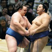 Gathering momentum: Baruto sends Kaio out of the ring at the Spring Grand Sumo Tournament on Monday. | KYODO PHOTO