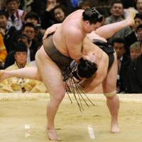 Top dog: Hakuho downs Harumafuji to win the Spring Grand Sumo Tournament with a perfect record on Sunday. | KYODO PHOTO