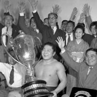 Devil is gone: Original former yokozuna Wakanohana, shown here after winning his first Emperor's Cup in 1956, passed away on Wednesday in Tokyo. Wakanohana won 10 championships before retiring in 1962. | KYODO PHOTO