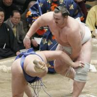 Saturday night special: Baruto flips Tamawashi to the ground at the New Year Grand Sumo Tournament on Saturday. | KYODO PHOTO