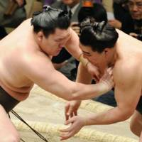 Show of strength: Hakuho (left) and Harumafuji square off at the New Year Grand Sumo Tournament on Thursday in Tokyo. | KYODO PHOTO