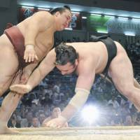 Too close for comfort: Kisenosato (left) and rival Kotooshu square off on the 12th day of the Nagoya Grand Sumo Tournament. Kisenosato defeated Kotooshu. | KYODO PHOTO