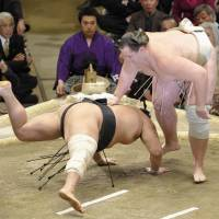 Down you go: Baruto (right) defeats Aminishiki on the sixth day of the New Year Grand Sumo Tournament at Ryogoku Kokugikan. | KYODO