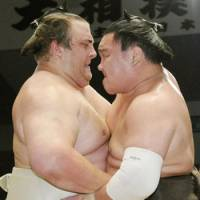 Tug of war: Yokozuna Hakuho and ozeki Baruto vie for a win during the Nagoya Grand Sumo Tournament on Friday. | KYODO
