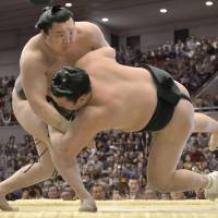 Still perfect: Yokozuna Hakuho improves to 8-0 by beating Ikioi at the Spring Grand Sumo Tournament on Sunday in Osaka. | KYODO