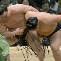 The king and I: Hakuho (left) grapples with Goeido at the Spring Grand Sumo Tournament in Osaka on Friday. Hakuho won to clinch the title. | KYODO