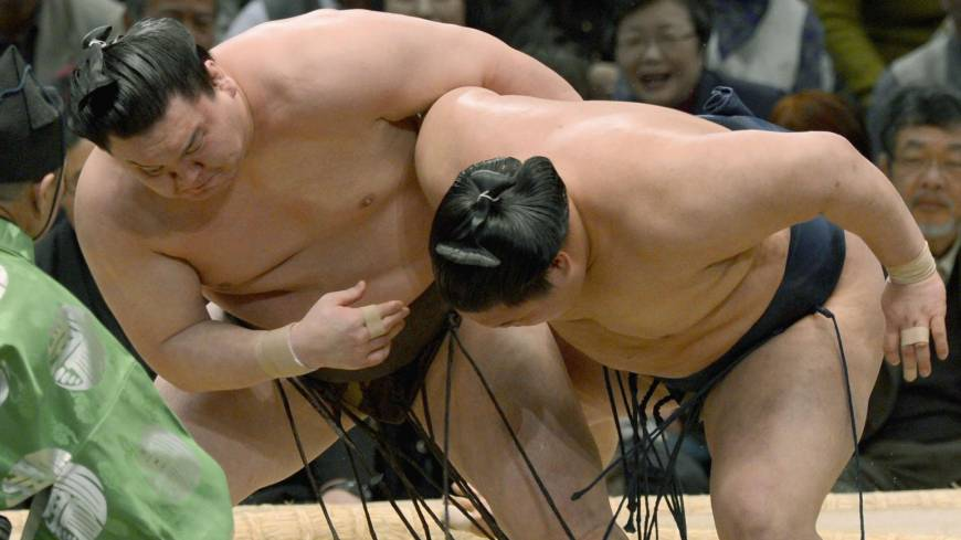 The king and I: Hakuho (left) grapples with Goeido at the Spring Grand Sumo Tournament in Osaka on Friday. Hakuho won to clinch the title.
