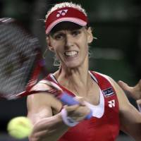 Chasing a title: Russia's Elena Dementieva hits a return to Italy's Francesca Schiavone on Friday at the Pan Pacific Open. Dementieva earned a trip to the final, winning 6-4, 7-5. | AP PHOTO