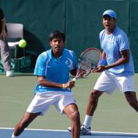 Staying alert: India's Rohan Bopanna (left) plays a shot as doubles partner Mahesh Bhupathi looks on during their Davis Cup World Group Playoff match against Japan's Yuichi Sugita and Tatsuma Ito on Saturday at Ariake Colosseum. | AP PHOTO