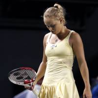 Surprise, surprise: Pan Pacific Open defending champion Caroline Wozniacki hangs her head during her upset loss to Kaia Kanepi on Wednesday at Ariake Colosseum. Kanepi beat the world's No. 1 player 7-5, 1-6, 6-4. | AP
