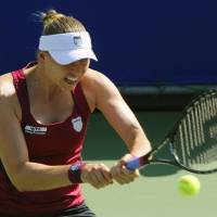 Speed and power: Russia's Vera Zvonareva hits a return to Czech Republic's Petra Kvitova in the Pan Pacific Open semifinals on Friday at Ariake Colosseum. Zvonareva beat Kvitova 7-6 (7-2), 6-0. | KYODO