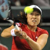 Get ready: Ayumi Morita hits a return against Tamaryn Hendler during their Fed Cup match on Sunday. Morita won 7-5, 6-2,  and Japan earned a spot in the World Group next year. | AFP-JIJI