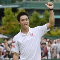 First time for everything: Kei Nishikori celebrates after beating Mikhail Kukushkin for his first win at Wimbledon. | KYODO