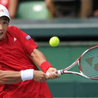 Strong effort: Japan's Go Soeda returns a shot against Dudi Sela of Israel during the Davis Cup World Group playoff singles match at Ariake Colosseum on Friday.  Soeda, Japan's No. 2, defeated the Israeli No. 1 6-2, 6-4, 3-6, 6-4. | AFP-JIJI
