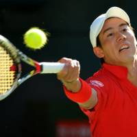 All to play for: Japan's Kei Nishikori plays a shot against Israel's Dudi Sela during their Davis Cup World Group Playoff at Ariake Colosseum on Sunday. Nishikori won the match in five sets, but Amir Weintraub beat Go Soeda in the decisive rubber to give Israel a 3-2 victory. | AFP-JIJI