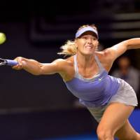 In position: Russia's Maria Sharapova stretches for a return against Heather Watson of Britain during their women's singles second-round match at the Pan Pacific Open on Tuesday. | AFP-JIJI