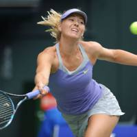 Go get it: Russia's Maria Sharapova returns a shot against Samantha Stosur of Australia during their women's singles quarterfinal match at the Pan Pacific Open on Thursday. Stosur defeated Sharapova 6-4, 7-6 (12-10). | AFP-JIJI