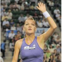 Saluting the crowd: World No. 3 Agnieszka Radwanska beats Angelique Kerber 6-1, 6-1 on Friday in the Pan Pacific Open semifinals in Tokyo. | KYODO
